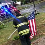 Resident: Paramus Firefighter Raises Fallen Stars And Stripes During Storm