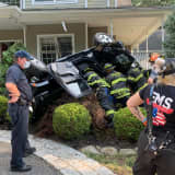 Photos: Vehicle Overturns After Crashing Into House In Area