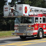 Emergency Responders Extricate Driver From Overturned SUV In New City