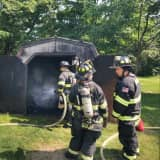 Monroe Volunteer Firefighters Extinguish Shed Fire