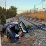 HEROES: Police Rescue Victims After SUV Rolls Off Route 17 Onto Railroad Bed