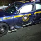 Driver Violates Move Over Law, Hits State Police Cruiser, Injuring Trooper