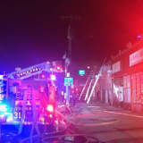 Firefighter Injured In Two-Alarm Blaze That Damages Row Of Stores In Westchester