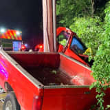Driver Trapped After Truck Crashes Into Telephone Pole In Trumbull