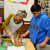 Valhalla Middle School Program Makes, Decorates Gingerbread Houses