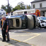 Oakland Multi-Vehicle Crash: Land Rover Upended, Police Car Struck