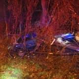 Car Goes Off I-95 In Westport, Lands In The Woods
