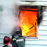 PHOTOS: Fierce Fire Roars Through Three Passaic Homes, Displacing Dozens