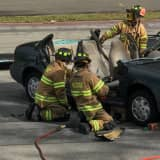PHOTOS: How Do Those Heroes Free People Trapped In Cars? Ramsey Rescue Shows Youngsters