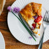 Enjoy Summer's Harvest With A Roasted Tomato Leek Tart