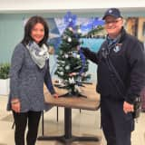 Stamford EMS Brings Holiday Cheer To Cassena Care With Christmas Tree Gift