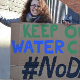 Dakota Access Pipeline Protesters March On Banks In Stamford