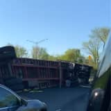 Overturned Tractor-Trailer Carrying Mulch Shuts Route 80 Exit Ramp In Paterson