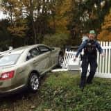 PHOTOS: Car Plows Through White-Picket Hawthorne Fence