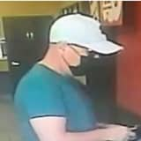 Man Wanted For Using Forged Debit Cards To Make ATM Withdrawals At Long Island Dunkin' Donuts