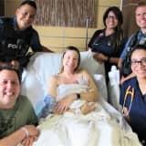 STORK CLUB: Newborn Greets Fair Lawn Police, EMS