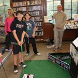 Kids Play Haunting Game Of Mini-Golf At Warner Library
