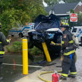 Sedan Impaled, Driver Injured In River Edge Crash