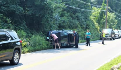 Driver, Passenger Treated By Paramedics After BMW SUV Rolls Over In Area