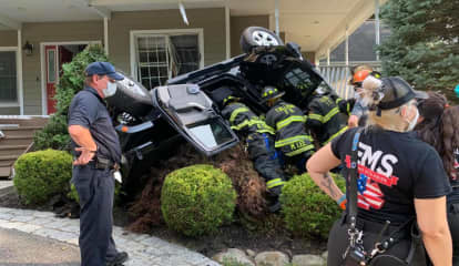 Photos: Vehicle Overturns After Crashing Into House In Rockland