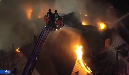 Firefighters Battle To Contain Roaring Multi-Building Paterson Blaze