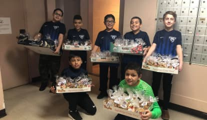 Englewood Soccer Club Youngsters Bring Holiday Cheer to City Elderly