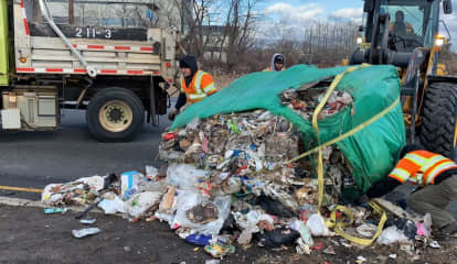 Truck Keeps Going After Dropping Ton And Half Of Garbage On Route 46 Ramp