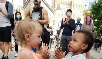 Photographer Captures Precious Moment During Jersey City Rally