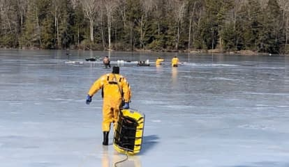 Firefighters Rescue Six From Pond After Falling Through Ice