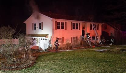 Photos: Resident Escapes After House Fire Breaks Out In Danbury