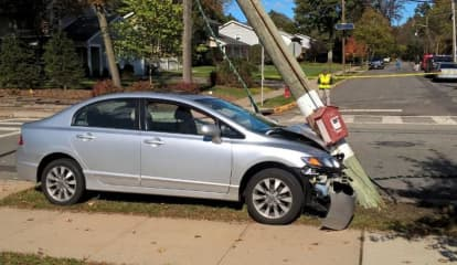 Sedan Topples Pole Outside Ridgewood School