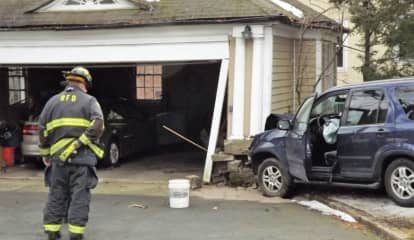 SUV Crashes Into Ridgewood Garage