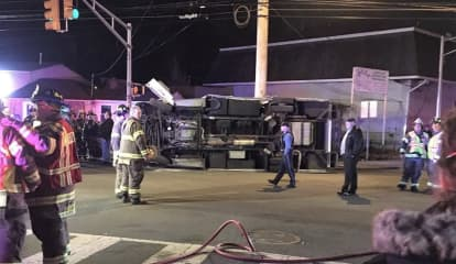 Hawthorne Ambulance Knocked On Its Side, Three Removed