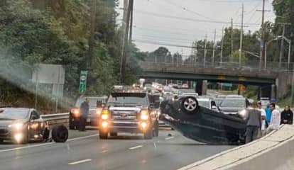 Driver Climbs Out After Rollover During Multi-Vehicle Crash On Route 208