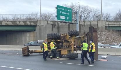Backhoe Hits Overpass, Topples Onto Route 17