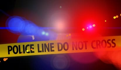 Man Found Dead Outside Bank In Area
