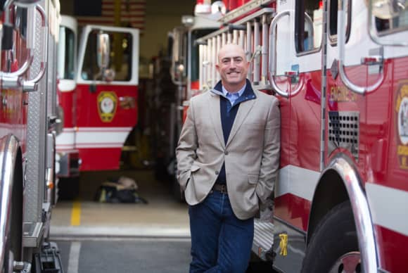 From fire house to school halls, Mark Bezos advocates volunteering
