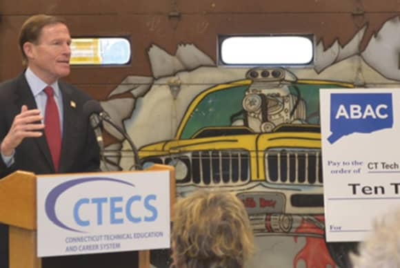 CT auto body group bangs out big check for program
