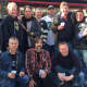 Joe Oriente, bottom left, Rich Leonarz, far right in the back row, and the musicians in Dads Night Band takes a break from making music at the 10th Annual Motorcycle Classic to throw back some brews.