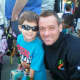 Aidan Walsh, owner of Ridgewood's Racefaster, LLC, and his 7-year-old son.