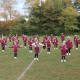 The Ossining Little League cheerleaders delivered opening routines, stunts and a halftime show at Saturday Night Lights.