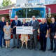 Capacity Coverage presents a check to the Mahwah Fire Department for new equipment.