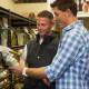 Luca Shelesky helps a customer at Thomaston Feed.