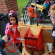 Kindergartners in Mount Pleasant made their own apple cider using the school's apple press.