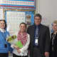 Nicole Cocchiola with Schools Superintendent James J. Albro and staff.