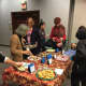 Ridgewood Public Library patrons enjoy some cookies. The village will have a cookie baking and eating contest Friday.