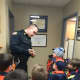 Ramsey Cubs Scouts pay visit to Ramsey police department.