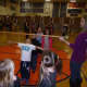 Students play limbo as part of Catholic School Week at St. Leo's in Elmwood Park.