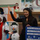 """Pre-kindergarten and kindergarten students enjoyed hearing the book """"Snowmen at Night"""" read aloud while watching adults act out the story."""