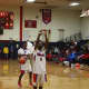Members of Peekskill High School's boy's basketball team warm up at senior night.